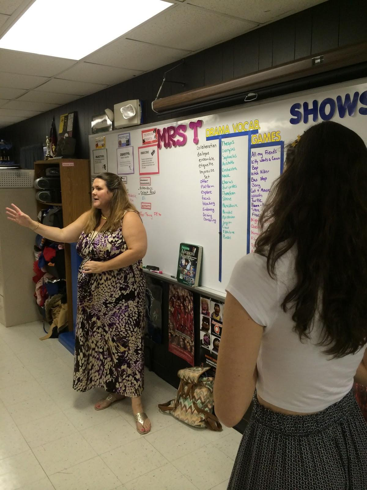 "Burgandy Trimmer, left, and Sabrina Palazzo, right, explain how to play the improv game ""Revolving Door"" to a group of advanced Theater 2 students."