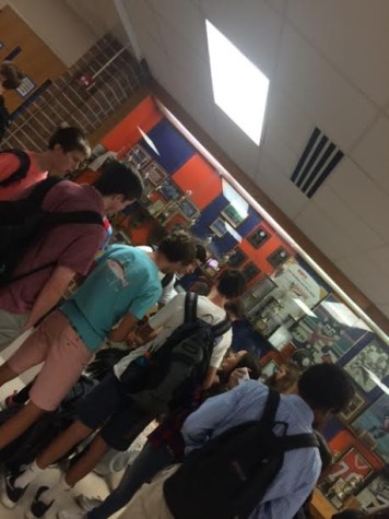 Freshmen socializing in Gym Lobby at lunchtime during the first week of school.