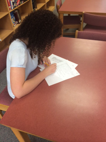 Dana Shefet, sophomore, takes an English test in the Library at Athens Drive.