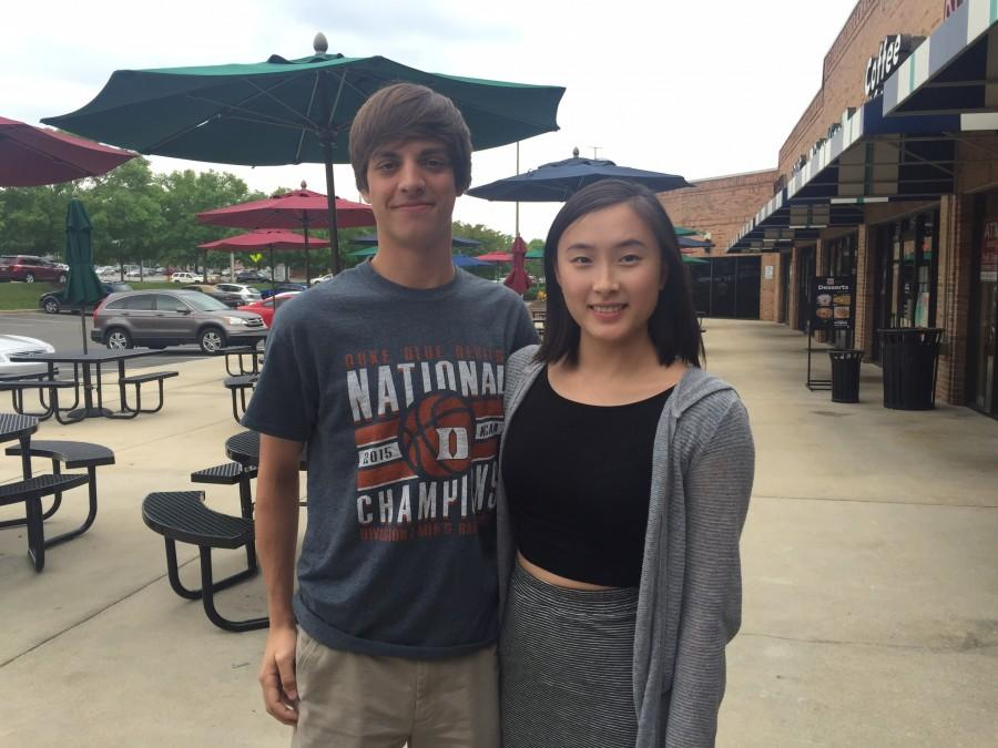 Ryan Suggs (left), and Jennifer Li (right) pose after an National Honors Society board meeting