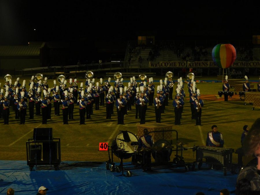 The Athens Drive marching band marches across the field and the Homecoming game, October 6, 2017.