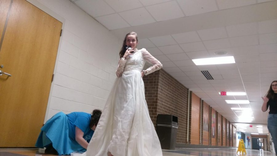 "Leila Elmore, sophomore is getting fitted for her character's appearance in ""Burning Love"", the finale of ""All Shook Up""."