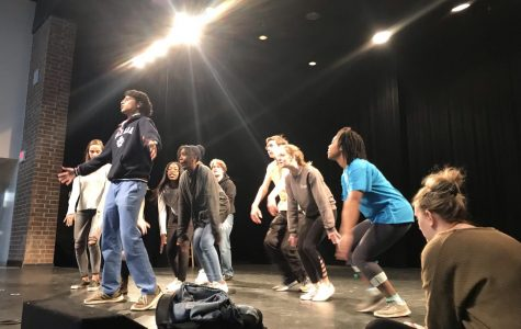 "Members of the cast of ""All Shook Up"" review choreography for the music of Elvis Presley. This includes iconic songs such as ""Blue Suede Shoes"" and ""C'mon Everybody""."