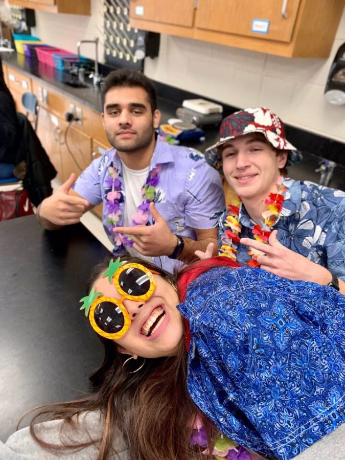 From left to right: Aadil Mehasnewala, Amira Tremelling, and Charlie Morlock dress up for Tropical Tuesday. Provided by Katie Vick