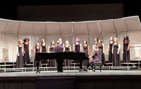 "Women's Chorus performs ""Stopping By Woods On A Snowy Evening"" at Meredith College for Music Performance Adjudications."