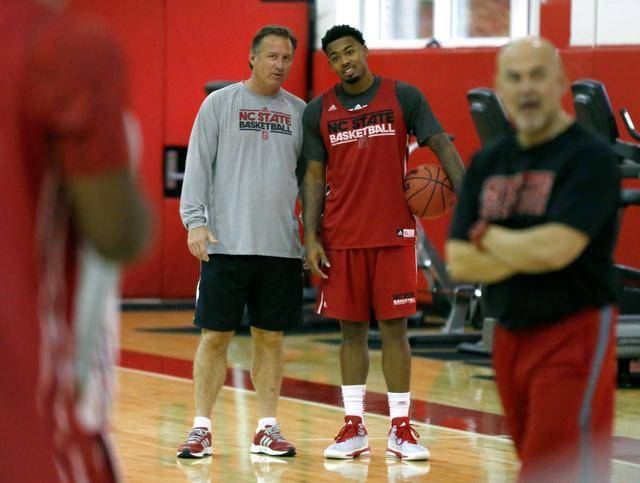 Mark Gottfried (left) coaches an NC State basketball practice in 2013.