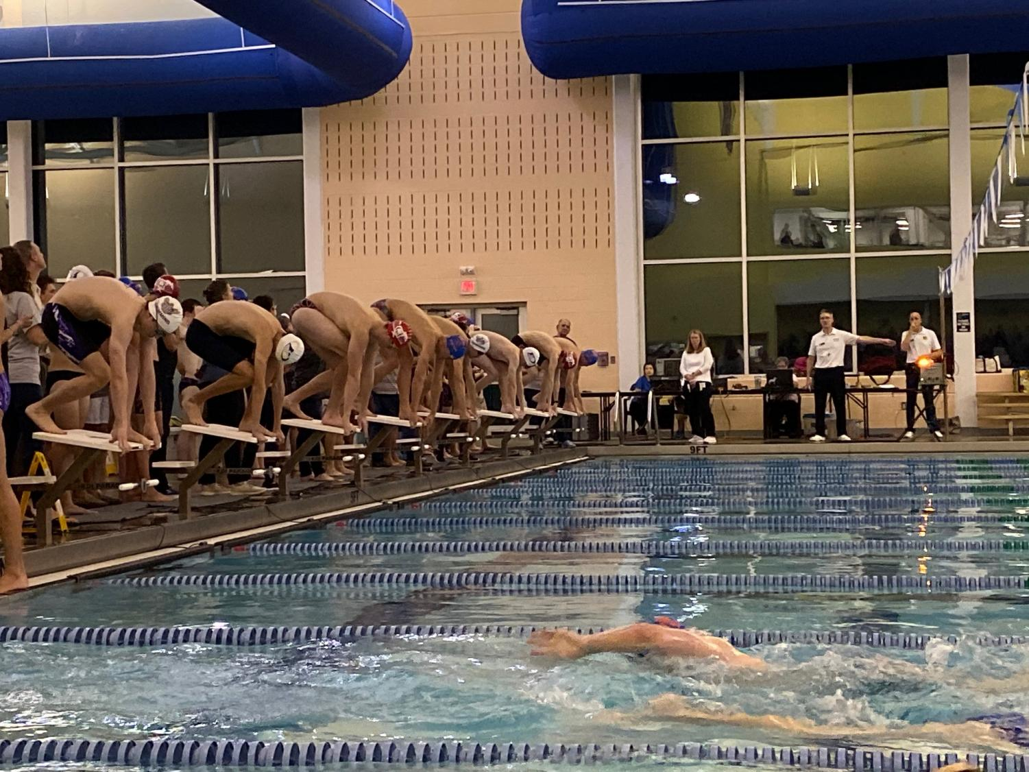 Swimmers+take+their+mark+and+prepare+to+race+at+the+Smithfield+Aquatic+Center+Photo+courtesy+of+Jankhna+Sura