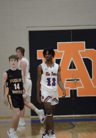Junior, Barry Brain in home basketball game against Fuquay-Varina High School
