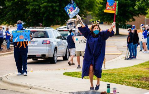 Trena Kirby cheers on students during the cap and gown pickup. Picture taken by Elizabeth Luna.