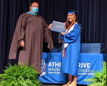 Amira Tremelling, Athens Drive student from class of 2020, poses with her diploma at graduation. Tremelling is attending UNC Wilmington.