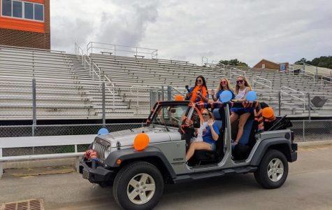 Rebecca Elliott, Addy Gilpatrick, Gracie White, and Brenlee Shaw celebrate their senior year while riding through Jaguar Stadium