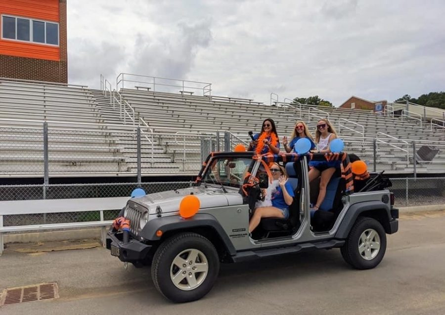 Rebecca Elliott, Addy Gilpatrick, Gracie White, and Brenlee Shaw celebrate their senior year while riding through Jaguar Stadium