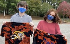 Will Wakeford and Leila Elmore show off their tie-dyed shirts