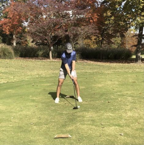 Spencer Haskell prepares to hit tee shot at Treyburn Country Club.