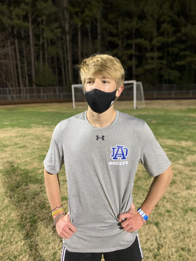 Zach+Peterman%2C+senior%2C+cools+off+after+the+soccer+team%27s+one+mile+warm-up+run+in+preseason+training.