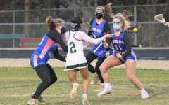 Athens' women's lacrosse team plays a game with masks on.