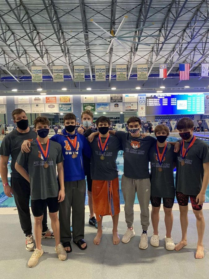 From left to right, Shane Barry, Matthew Goembel, Victor Haxholdt, Joey Bridgham, Ryan Silver, Will Shearin, Evan Carlson and Thor Dyke pose after state championships.
