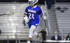 Senior Ethan Barbosa carries the ball to the opposing teams goal