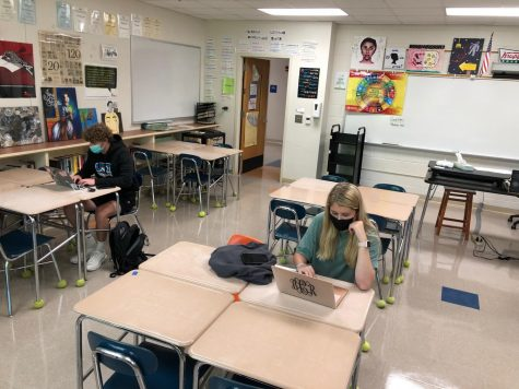 Juniors Coley Smith and Brenna Corregan complete assignments in-person while most of their classmates participate virtually in AP English III.