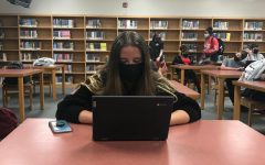 In-person students like Carolina Beacham (pictured) take class virtually from the library if their teacher is not on campus.