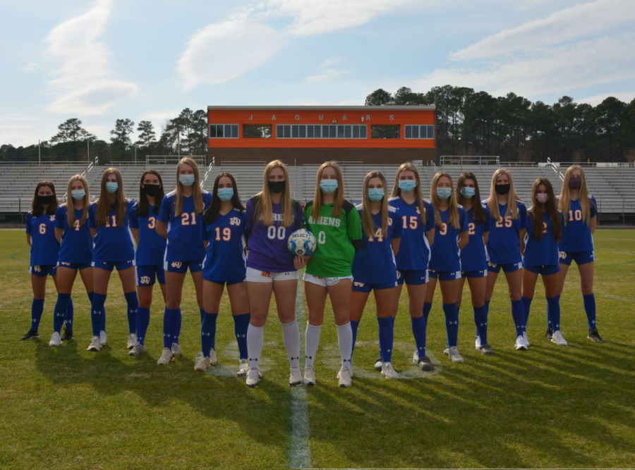 Athens Drive Women's Varsity soccer team poses for a team pictures before heading to playoffs.