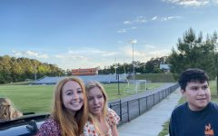 Katelyn Harris, Sierra Freer, and Will Sanchez enjoy the drive through Jaguar Stadium.