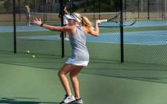 Cassidy returns serve during match at Green Level High School.