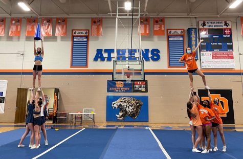 The Varsity cheer team doing a team bonding game in which they try to make the tallest stunt.