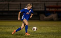 Junior Laura Cate Westerbeek controls the ball while playing at a home game