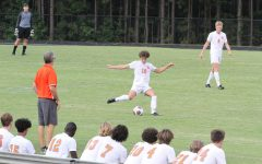William Angell, senior midfielder, kicks the ball down the field to give the team a chance to score against Apex. Final score 3-0 Apex. Photo contributed by Caiden Orders.