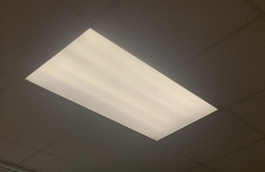 Harsh white fluorescent lights students are exposed to seven hours a day.