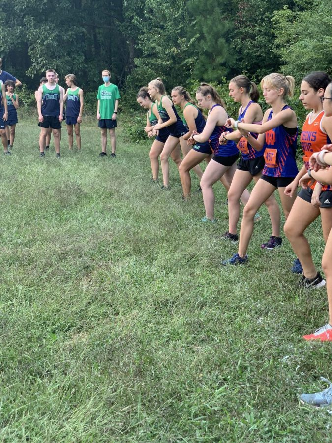 The athletes of the Womens cross country team getting ready to race.