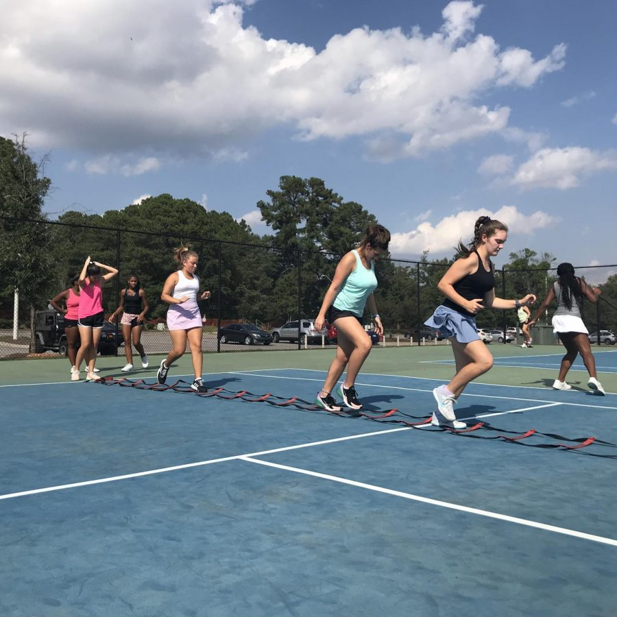 Following dynamic stretches, the Women's tennis runs sets of ladders, improving foot-eye coordination and speed.