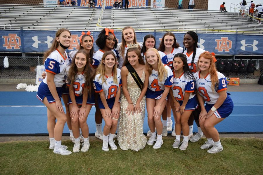 Athens Drive High School cheerleaders team celebrating their captains win Homecoming Queen, Eliza Magana.