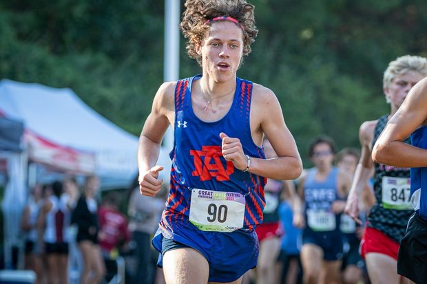 Noah Valyo, sophomore, running in an invitational track meet which was held at the WakeMed soccer park running the 5k (3.1 miles) against other student athletes in Wake County.